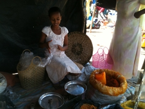 Young girl selling spices