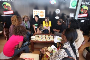 Me in the Zone, discussing male and female condoms with a group of women from the Community Village